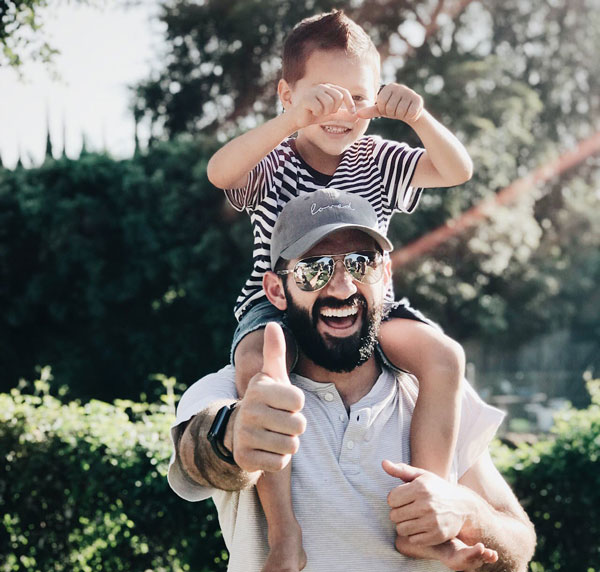 father-lifting-up-son
